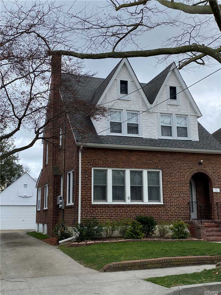 Charming Tudor with spacious rooms, beautiful hardwood floors, craft-tex walls. Full finished basement. Nice yard.  Convenient to schools, shopping, houses of worship and transportation  MOTIVATED Owner wants to hear ALL offers