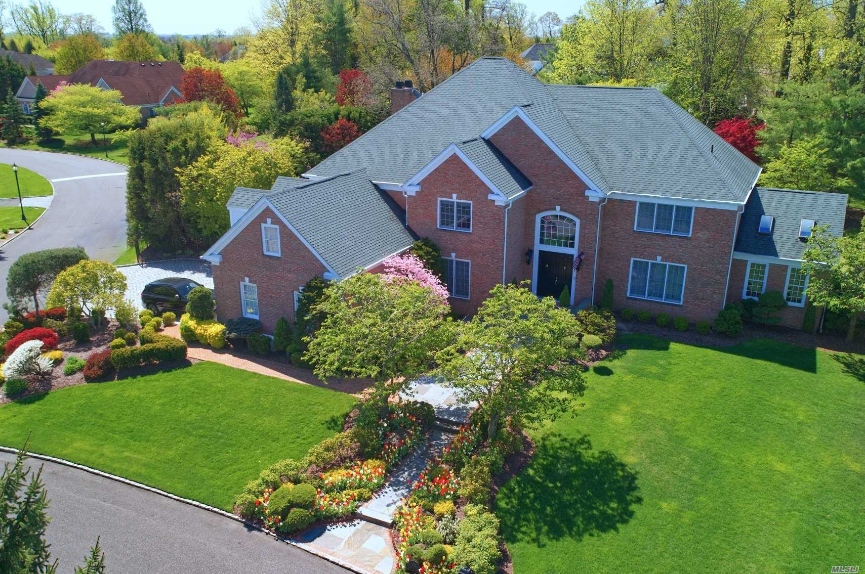 VIDEO PROPERTY TOUR LINK A MUST WATCH!!! STONE HILL ALLURE Spectacular all brick estate within a private cul de sac inside North Shore's most sought after gated community. Boasting 5 bedrooms, 5.5 baths, a dramatic 2 story entry foyer, open living room layout, formal dining room, separate sunroom with skylights, gourmet eat-in-kitchen with wall oven, all high end appliances, desk area and separate sun drenched breakfast room. Family room with soaring ceilings and access to the private landscaped yard and koi pond. A total of 5 bedrooms, one of which is located on the first floor with a bathroom, a large master en suite with two separate bathrooms and 4 closets. Full Attic is ideal for extra storage if needed and a 3 car garage. Lush grounds are a serine setting for relaxing or entertaining. Common Tennis Courts, 24 hour gate house, roving patrol and snow removal are some of the amenities worth mentioning in this magnificent gated community you may call home.