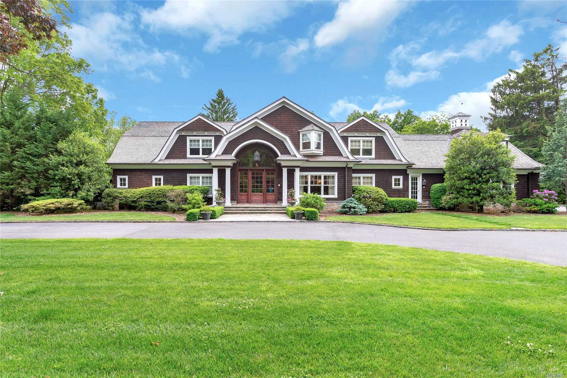 OLD WESTBURY. Spectacular Colonial Located On Over 2 Private Acres In The Village of Old Westbury. This Stunning Hamptons Style Home Features 5-Bedrooms, With Master Suite On The Main Level, And 5.55 Baths. With A Lot of Natural Light Throughout, Including Radiant Heated & Pine & Walnut Floors, Built In Speakers, Open Living Room With Stone Floor To Ceiling Wood Burning Fireplace & 2nd Floor Balcony, Breathtaking Sunroom With Fireplace & Access to Back Patio, Great Game Room/Den With Bar, Fantastic Chefs Kitchen With Breakfast Nook & Butler Pantry With Access to Formal Dining Room, Inground Heated Gunite Pool & Patio For Great Entertaining, And Much More!!