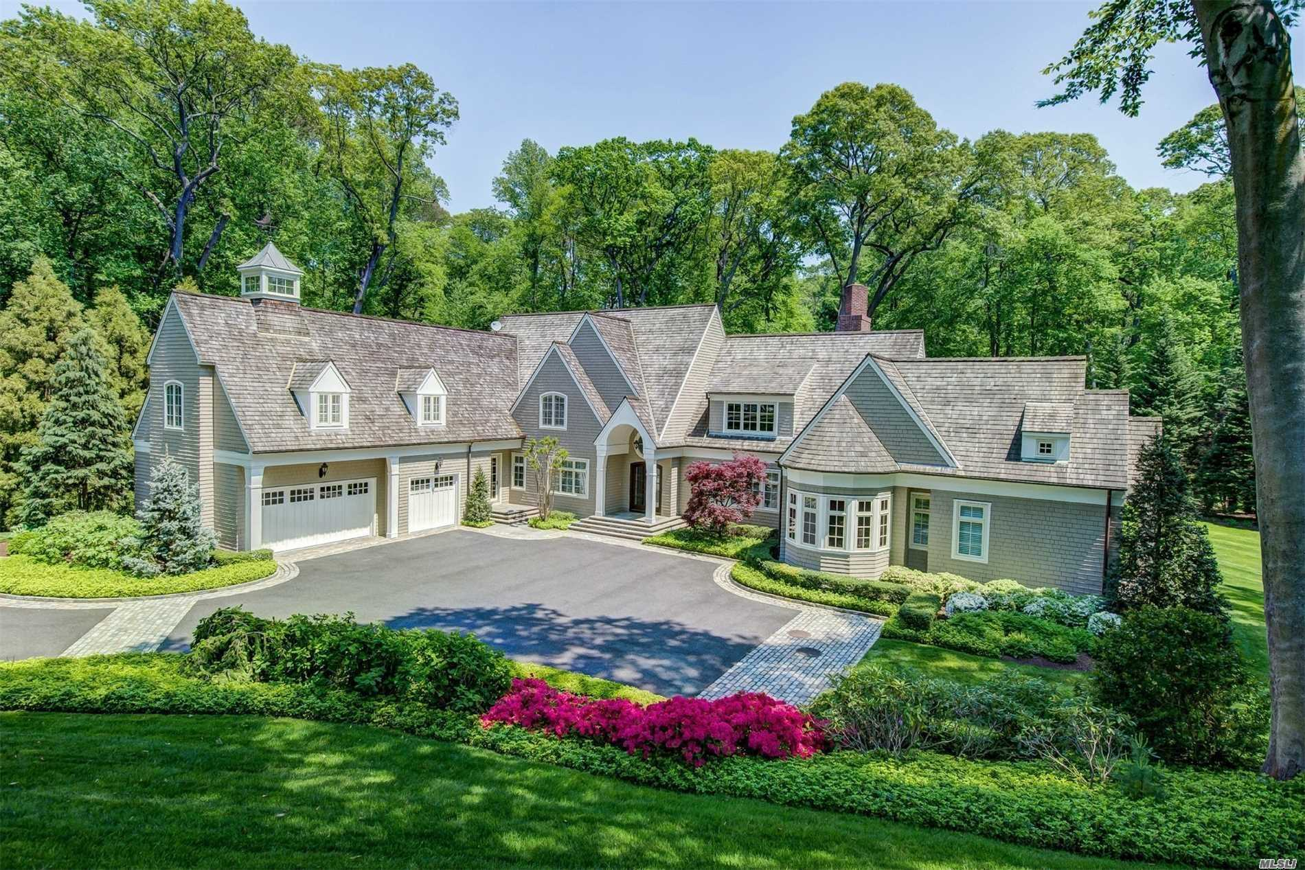 Tucked away on 5 lush acres with high ceilings and beautiful architectural details throughout is this custom 2002 residence. Exquisite millwork throughout and a fabulous first floor master suite. The residence also features two private home offices. Boasting a gourmet kitchen, large family room with fireplace. Finished lower level with paddle court, gym & game room. Minutes from a nature preserve & close to shops & restaurants & beaches HOA fees. Ask about virutal tours,Matterport,survey and floor plans