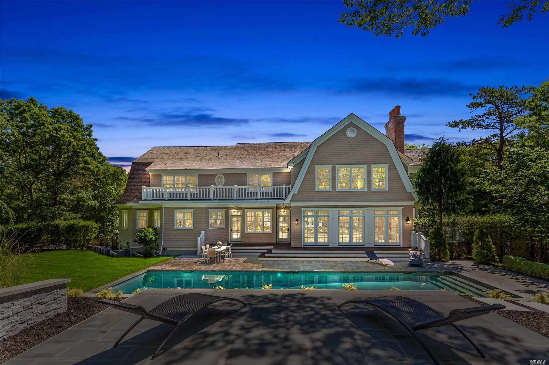 This palatial estate in the center of the Hamptons provides every amenity necessary for a life of luxury. Completely renovated and updated for the 21st century with over 6,900 square feet and situated on 2.7 acres of land. This spacious colonial contains plentiful entertainment options; a theater room, a sauna, a gym, a bar, a library, a gunite heated swimming pool, outdoor and indoor fire places, a ballroom, smart home connections, an open concept basement, a 3 car garage, a butler's pantry, and a maid's room.