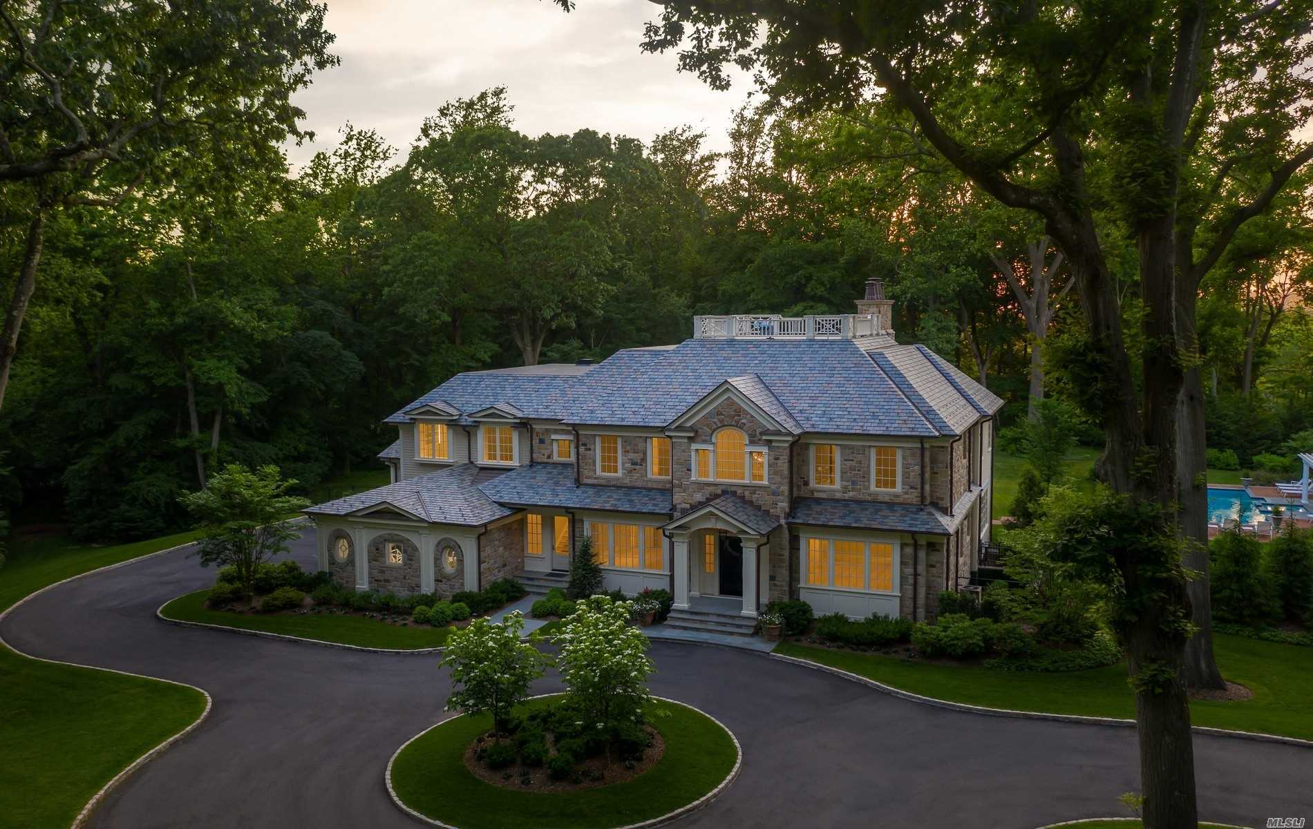 """New Construction! Extraordinary Custom Stone Colonial located in the Prestigious 160 Acre Gated Community of Spring Hill at Old Westbury. Unparalleled Quality! Vermont Slate Roof, White Oak Plank Floors, 26' Two Story Entrance Foyer, Detailed Moldings and Finishes Enhance Sophisticated and Beautifully Detailed Entertainment Rooms. Six Bedrooms En-suite plus a Lavish Master Suite features a Sitting Room, Two Closet Rooms and Marble Master Bath. Library, Guest Wing, Four Fireplaces. The Lower Level offers Great Entertainment Space with an Attractive 1000 Bottle Glass and Mirror Wine Room, 75"""" TV, 2 Lane AMF Professional Bowling Lanes and Glass Enclosed Gym. Six Professional Landscaped Acres Offer Privacy and a Luxurious Outdoor Setting. Covered Porch, Expansive Patio and Beautiful Pool Setting. Property has been Prepared for a Tennis Court. Designed, Built and Landscaped by Kean Development. Gated and Manned Security, Lake and Boat House. Resort Lifestyle! Roslyn School District."""