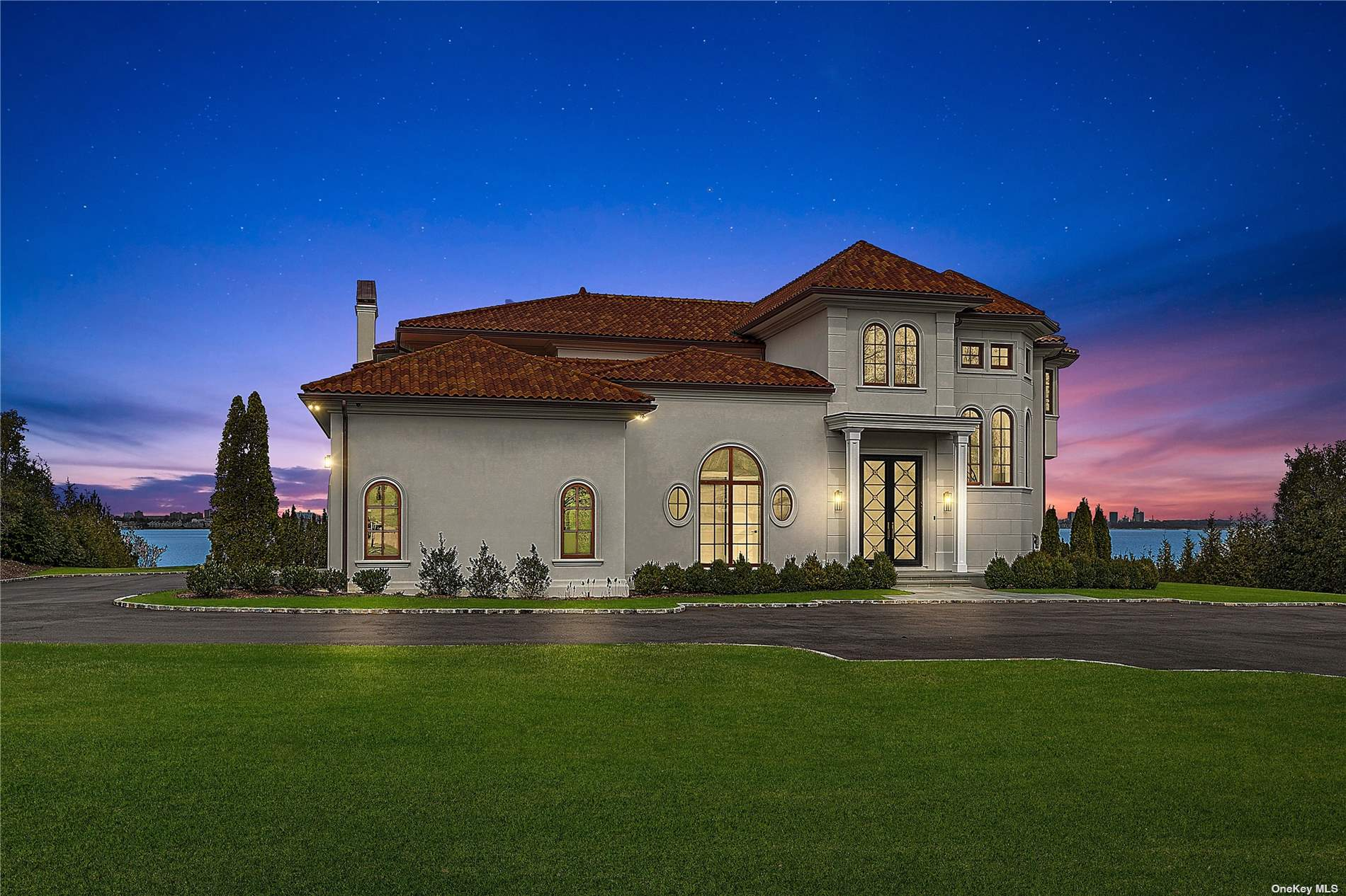 BREATHTAKING WATERFRONT OFFERING Expansive water views of the Long Island Sound, Manhattan, Throgs Neck Bridge, Westchester and Connecticut may be enjoyed year round within this elegant new construction in the Prestigious Village of Kings Point. Privately located the end of this beautifully tree-lined cul de sac, this artistically-inspired residence is currently being completed by well known and respected Rockwell Developers LLC. The attention to detail with a clean lined approach is apparent the moment you enter this magnificent residence with its elegant curved staircase, formal dining room with custom walls and gold lined accent,herringbone wood floors, an oval shaped custom blue colored library or office with walls of windows and FPLC, and the inviting eat-in-kitchen with custom cabinetry, marble countertops, and high end appliances, just to name a few. 1.46 Acres of water and private beachfront.