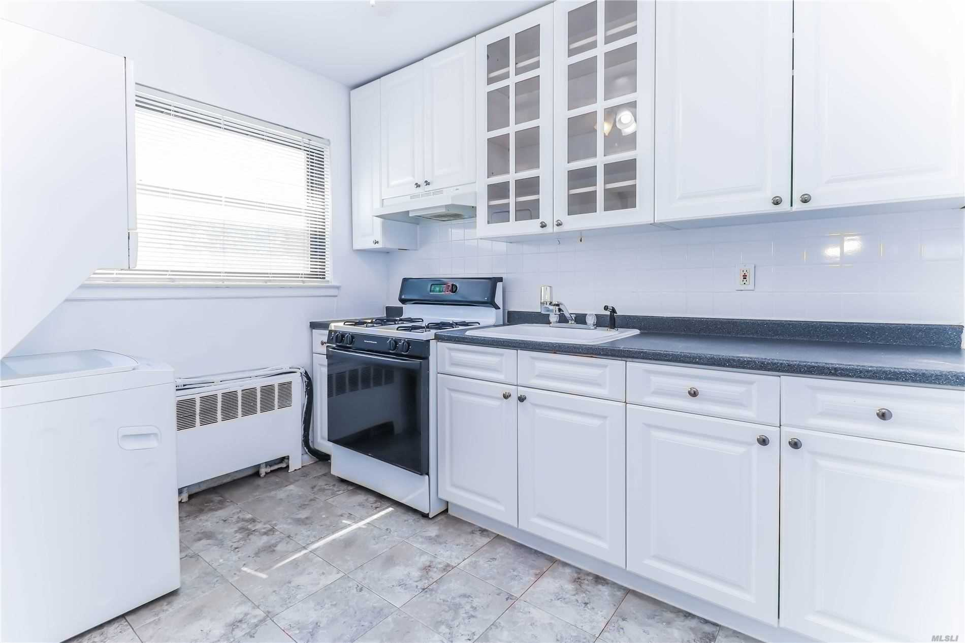 Renovated 2 Bedroom. Located in Thriving Neighborhood of Bayside with acres of park land, trees and walking paths. Windsor Oaks is often described as Living Inside and Oasis. Convenient to public transpotation and highways. Free outdoor parking available as well as indoor garage for rent. A Must See!