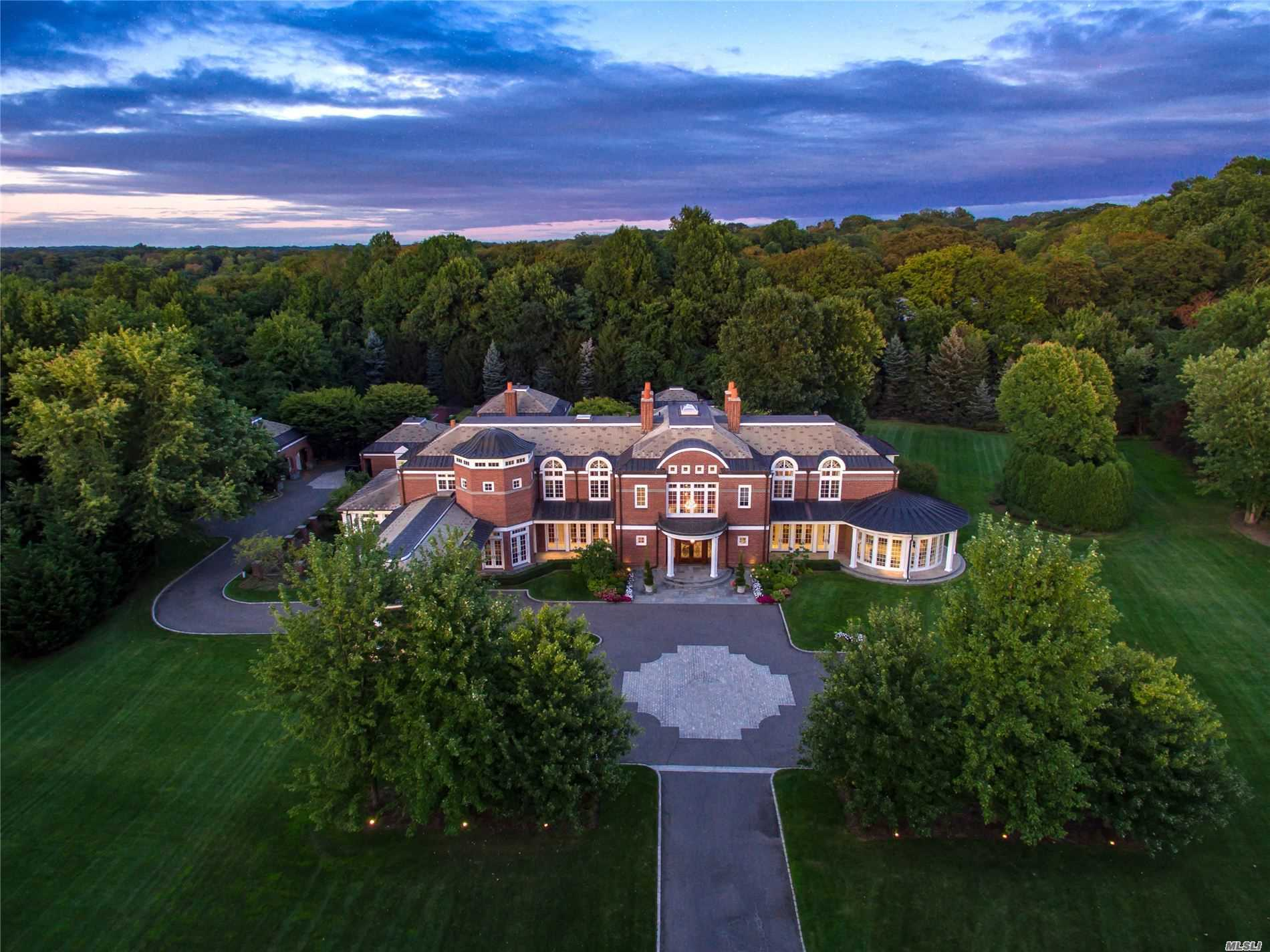 Situated on over 6 acres of perfectly manicured property and located on one of the most prestigious streets on the Gold Coast of Long Island, this custom-built estate simply embodies perfection. Past the automatic gates, a quarter-mile long undulating private driveway leads to the all brick residence with amenities including a fully integrated Crestron and Lutron systems, an in-ground pool, cabana with full kitchen, and bathroom, tennis court, hot tub and zoned in the top-ranked Jericho School District.