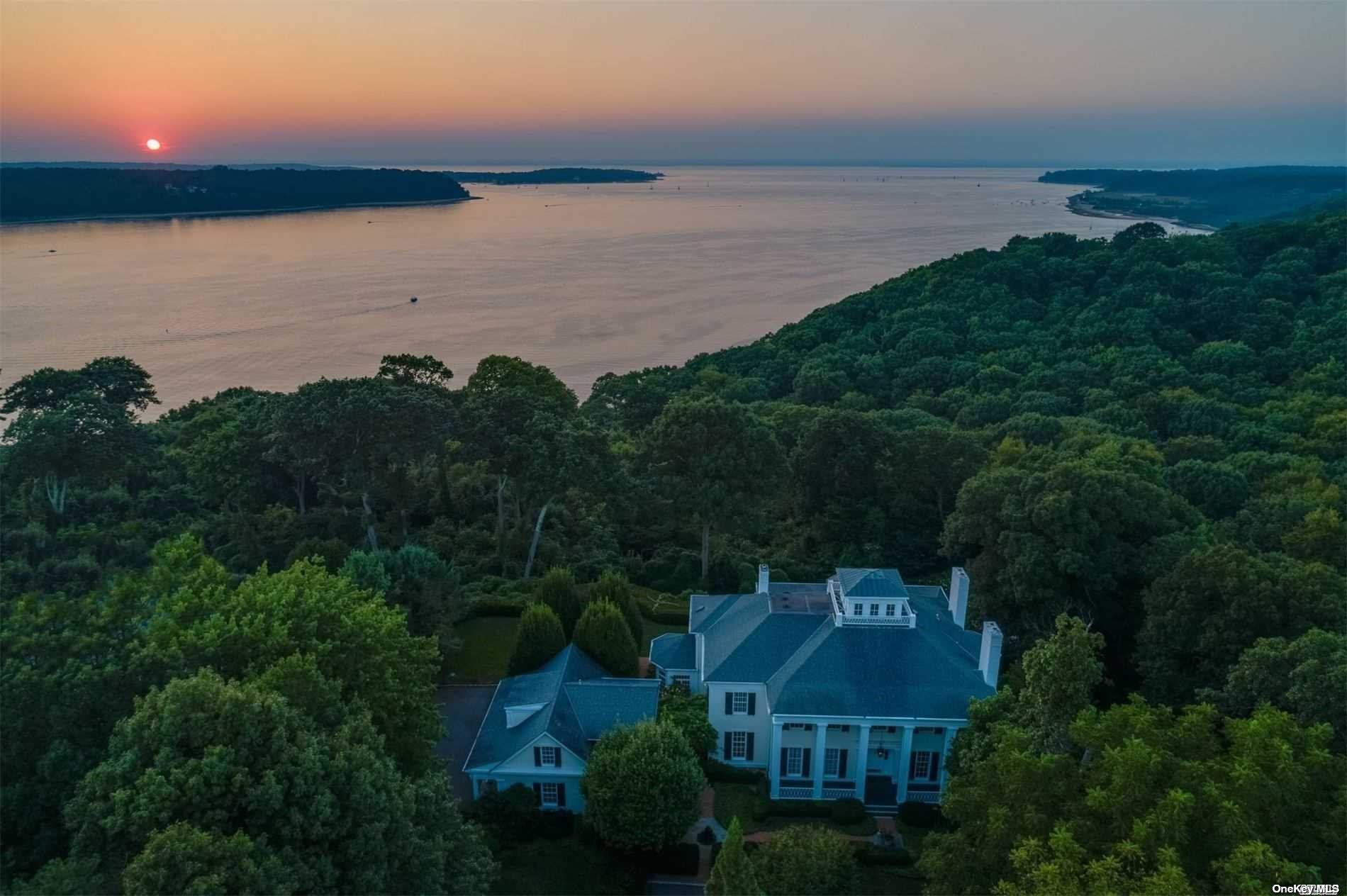 Waterfront architectural masterpiece overlooking Cold Spring Harbor to Centre Island and beyond with breathtaking panoramic sunset views from most every room. Custom built in 1996, by Kean Development and Andrew Giambertone Architects, with striking details including dramatic 3 story foyer and sweeping staircase, intricate millwork, 13ft ceilings, authentic gas lanterns and multiple expansive covered porches. Encompassing 3.2 acres at end of cul-de-sac in sought after Burrwood Estates, this impressive property includes separate guest quarters above 3 car garage, newly updated gunite salt water heated pool with hot tub, and Summer cabana. Nearby Jennings Beach Association and Lloyd Harbor Village Beach with mooring rights (fee).