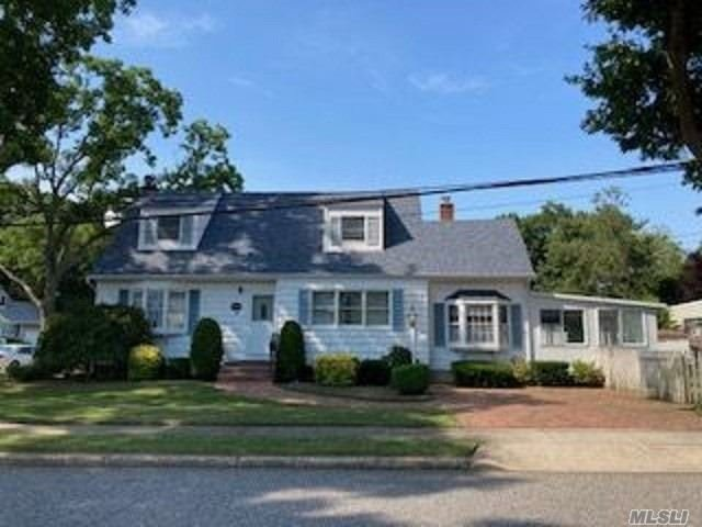 Nicely Maintained Cape Home Originally Built in 1956 w/1492 Square Feet. Featuring Living Rm, Dining Rm, Kitchen w/Dining Area, Family Rm w/Wood Burning Fireplace, Br. Updated Full Bth & 3 Season Rm on 1st Fl. 2nd Fl has 2 Large Bedrooms w/Jack & Jill Full Bath. Full, Part Finished Basement, Hardwood Floors, Oil Hot Water Heating System, Inground Sprinklers on 63' x 119' Property. Farmingdale Schools.