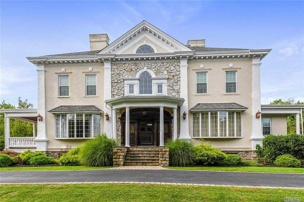 Stately Historic 1873 Andrews Estate Colonial Located in the Private Oak Neck Harbor Estates Subdivision South of Montauk Highway. Features 5,980 SF on 3 Floors. EF, LR, FDR, EIK, Fam Rm, Office & Laundry Rm on 1st Fl. 2nd Fl has MBR w/MBth, Guest Suite w/MBth, 3 More BRs & FBth. 3rd Fl has 3 BRs, FBth & Rec Room w/Wet Bar. Finished Bsmt w/Fam Rm, Full Bath, Wet Bar & Door to Backyard. 2-C Att Garage, Covered Porch, 6 Fireplaces, Crown Moldings, Marble Floors, 18' x 38' IGP, IGS, Alarm and Situated on Fenced .81 Acre Parcel. Suitable for Extended Family. $50,000 Price Reduction!