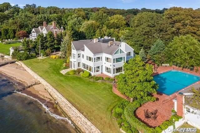VIEWS, VIEWS & MORE VIEWS!!!! Extraordinary Gold Coast Waterfront Retreat in Sands Point--Just shy of 4 acres, this home features panoramic views of the Long Island Sound & the Manhattan Skyline.  With 225 ft of Beach Front & a deep water dock it's the perfect  Hamptons-alternative.  It also features a separate Movie Theatre (separate building), IG Saltwater pool with pool house, tennis ct w/Tennis house, separate cottage with water views, Dog House for the pets complete with dog run, beautiful green lawns, and over 8,000 sf of gold coast living.  The home boasts 7 bedrooms, 11 baths, gourmet eat-in-kitchen, Massage Room with Sauna, and many more amenities.  Enjoy the water views from almost every room in the house---live like every day is a vacation! Exceptional craftsmanship, spectacular sunsets, the ultimate waterfront experience!!