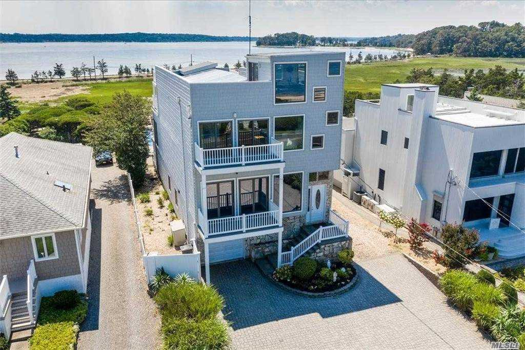 Multi-level waterfront home with spectacular views of both Long Island Sound & Northport Bay! The open & spacious layout offers radiant heated floors throughout and 9ft ceilings on the first floor. Beautifully updated center island kitchen w/granite tops and high end appliances. Master suite offers large walk-in closets, full bath and balcony with sweeping waterviews. Full walk out lower level w/2 large bedrooms, 2 baths and family room with sliders to deck and in ground pool. Access to your own private sandy beach. Enjoy both sun rises & sunsets from every room and the roof top deck! Owned Solar panels with battery pack. CVAC. Make your beach home dreams a reality!