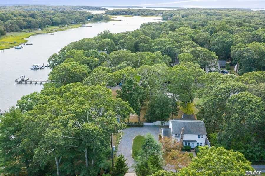 Beautiful waterfront Cutchogue home located at the end of a private road with 30' dock on East Creek.  Dock can accommodate medium to large boats of different kinds.   Enjoy breezy afternoons from your waterfront deck or gazebo. Entry way opens into living area with wood burning fireplace.  Sunroom with large windows looking out to the water.  Separate dining area.  Downstairs has a bedroom that could also be used as an office.  Other features include, 1 car garage, full/dry basement with billco doors, not in a flood zone, emergency generator included and low taxes!  Quick stroll to Peconic Bay beach at the end of Harbor Lane.  Close to town and all the North Fork has to offer!