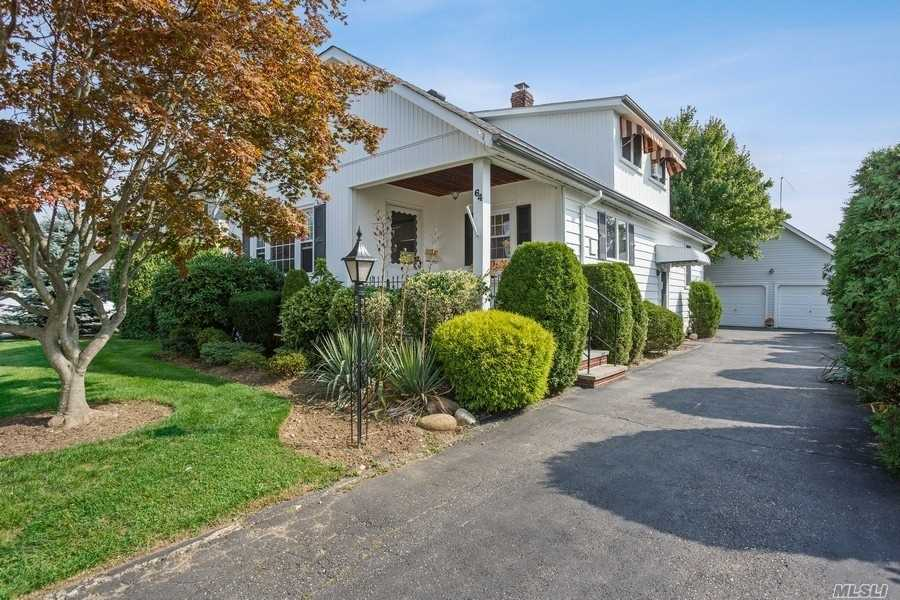 Bethpage schools. Charming 10 rm Craftsman located on quiet dead end.Building Square Footage (Approx): 1st Level 1,076sf, 2nd level 600sf, basement 1,076sf; garage 400sf, shed 73sf. Home features professional landscape, front porch, detached 2 car+ garage, hardwood flooring, moldings, high ceilings, eat in kitchen (gas stove), living room, dining room, 2 bedrooms on 1st level, full tub bath, bedroom on 2nd level with huge walk in closet (cedar), office/possible 4th bedroom, recreation/bonus rm (basement), laundry room with slop sink (basement), utility rm (basement), storage/workshop (basement), Peerless boiler (oil), hot water (steam) heat, newer Rheem gas hot water heater, updated electric, sprinklers, updated windows, newer roof, rear deck, long drive and private yard, r.e. taxes $10,931 with star under $10,000. Near Main St, 2 mins to LIRR, 3 mins to Bethpage State Park and  Bethpage Black Golf Course & Parkways, 35mi to NYC