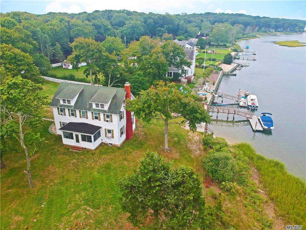 Incredible opportunity to own an expansive, 1 1/2 acre waterfront estate just 150 yards from Goose Creek Beach. 270' of total water frontage with 55' feet of bulkheading and private dock. House with five total bedrooms (three with water views), formal living room with fireplace and water views, plus two car detached garage, waterside patio and firepit, and outdoor shower. Plenty of room for expansion so bring your vision and your architect.