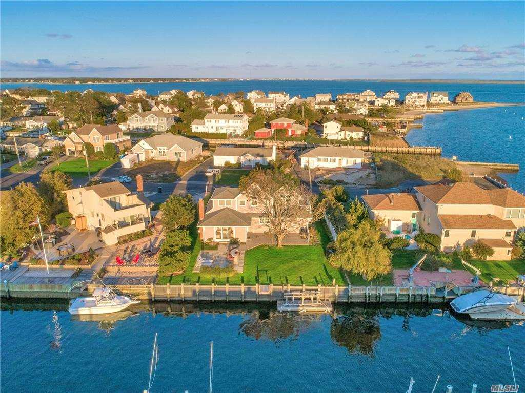 Once in a Lifetime, beautiful waterfront home in desirable Shinnecock Shores.  No detail has been missed in this stunning four bedroom, four bathroom Post Modern home.  Open concept living room, dining room and Kitchen.  There is a great room with a fireplace with views of the waterfront which leads to beautiful yard with outdoor patio and lush landscaping.  Paradise for the boat lover with 75 feet of bulkheading just steps to the boat dock for boating, kayaking, paddle boarding etc.  Enclosed Outdoor Shower.  New Bulkhead Refacing.   A unique opportunity that won't last!!!
