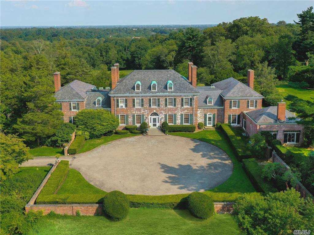 Commanding 108 acres, this immense and spectacular country estate includes a 26-room magnificent slate-roofed brick Georgian-style manor house built in 1932 by architect Henry Sedgwick for Robert Winthrop.  The house is characterized by beautiful architectural details, elegant and grandly scaled rooms, high ceilings, 10 wood-burning fireplaces, and pastoral vistas from every room. Numerous terraces surrounding the house overlook expansive lawns and offer opportunities for al fresco entertaining and relaxing. There is a pool and pool house, tennis court, playhouse, extensive stables and paddocks, a squash court, large barns, cottages and numerous out-buildings and garages all set amid  secluded rolling hills and woods and open fields.  Located in the incorporated village of Old Westbury, the manor house has 7 master bedrooms, 9 full baths and 3 half baths, ample staff quarters, a wine cellar, central a/c, and a generator.  Jericho/Westbury school districts. Approved sub-division.