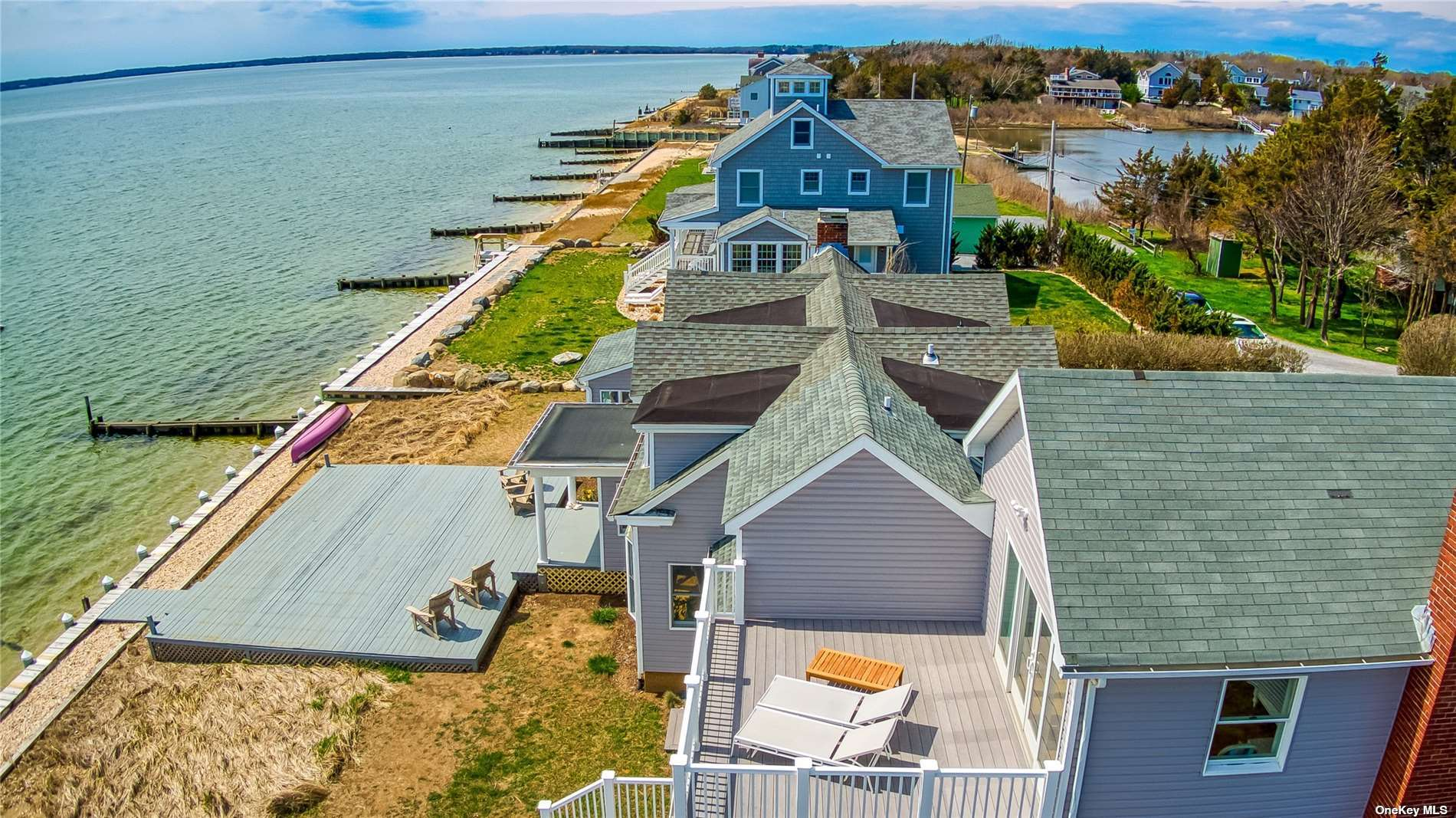 Spectacular Renovated Bayfront, embracing the prevailing southwesterly breezes & sweeping views over the Peconic Bay to the South Fork. Expansive waterside deck destined for entertaining & cocktails at sunset. Updated kitchen, formal DR, LR w/flp, sunroom, all with waterview's.  2nd flr  guest wing includes a guest ensuite with updated bath, 2 additional BRs w/ full updated bth.  On the East side of the house is a private master wing, LR w/flp , 2nd flr  master suite w/ waterview terrace & full bath. Great natural light throughout. North Fork living at its best.
