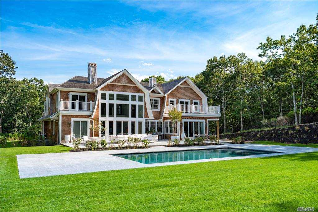This 9,500+ square foot manse sits atop a beautifully elevated 2 acres in coveted Sag Harbor with 7 bedrooms, 7.5 baths, soaring ceilings, custom Ciuffo kitchen, top of the line Kohler fixtures, designer tile work, travertine patio, heated gunite pool with shallow tanning shelf and spa, sumptuous master retreat, an enviable fully finished lower level. 600 amp. electrical service, back up generator, security system, CAT 6, and for those who wish, room for N/S tennis! Ready for occupancy late Sept 2020.