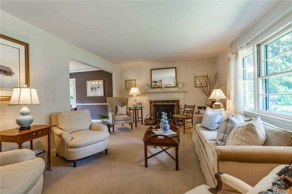 This home greets you as you enter into the living room with the fireplace as a focal point that has a sophisticated appeal. Easy ranch living with large flat property that was professionally landscaped located on one of Locust Valley's most desirable streets, adjacent to 43 acres of Bailey Arboretum. Convenient to the Long Island Sound with Lattingtown Beach & Golf rights. The basement is the entire house that awaits your touch to finish off and create an amazing space to fit your needs. Locust Valley Schools, close proimity to Village, trains, shops and restaurants. It's a gem that will go fast!