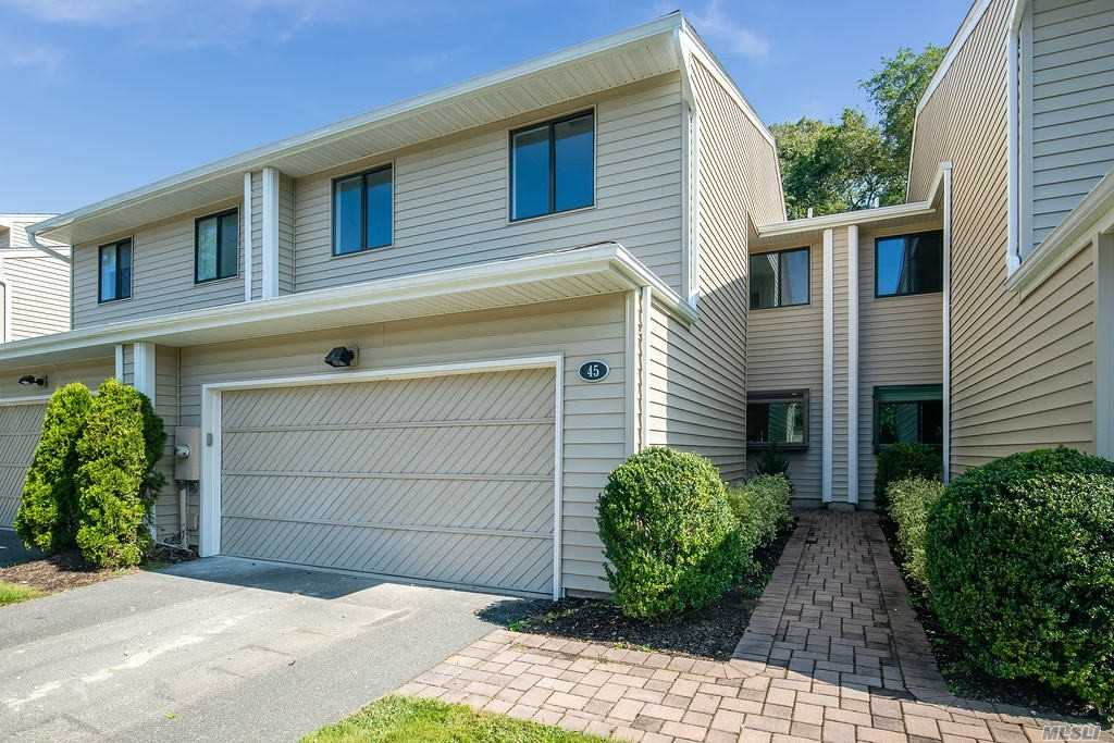 Beautifully Renovated Condominium in Woodbury Greens! Perfectly situated in the cul de sac.  Perfect Move In Condition! Great Open Floor Plan, with cathedral ceilings.  Gorgeous Gourmet Marble Kitchen. New Hardwood Floors.  Newly Finished Basement & Storage.  Double Door Master Suite with Two Walk-In Closets. Refinished Deck.  Pool, Tennis court, Basketball court down the block.  Town Golf, Town Park and Syosset Train Station Nearby.  Syosset Schools.