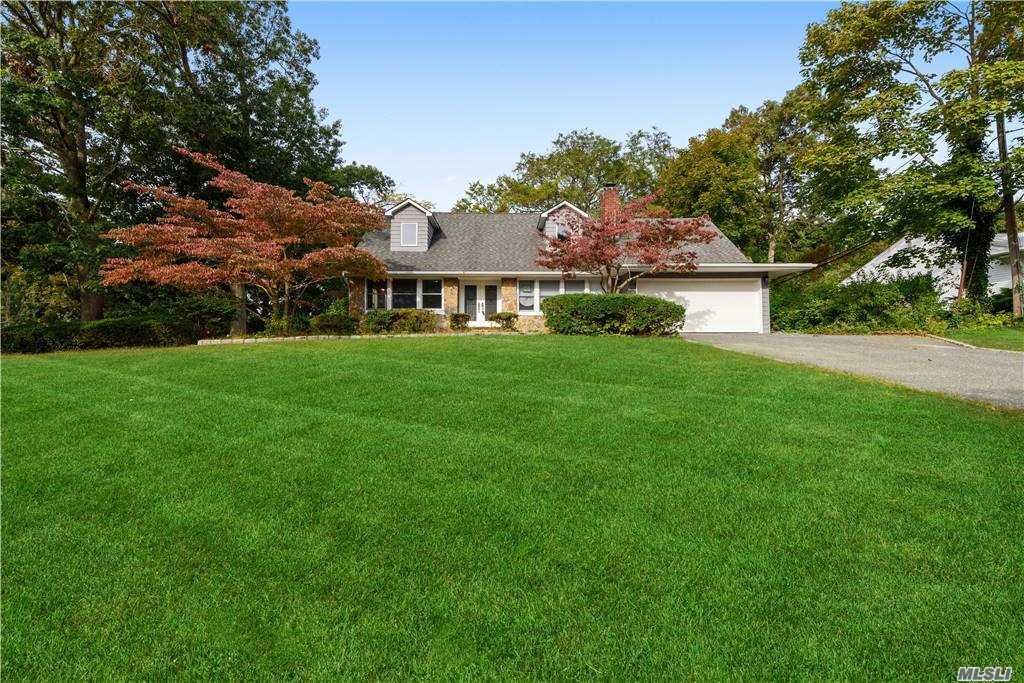 Fabulous Completely Renovated- Expanded Cape in Award Winning Smithtown SD,  3000 Square Feet of Living Space-Oak Walnut stained floors throughout- Living Room with FP, Family room, State of the Art Kitchen, with center Island seats 4, top appliances, Quartz Countertops, easy close doors,  Master Suite with Full Bath - with shower bench-large double vanity, and Walk In Closet, 3 Additional Bedrooms one with private bath- 4 Bathrooms completely renovated  with top of the line tile and amenities, Florida room with  alcove, attached 2 car garage, Corner Lot-Large Park-like setting with boundless entertaining potential, Open Floor plan, French Doors lead to Patio,-1600 square foot unfinished basement with huge potential-