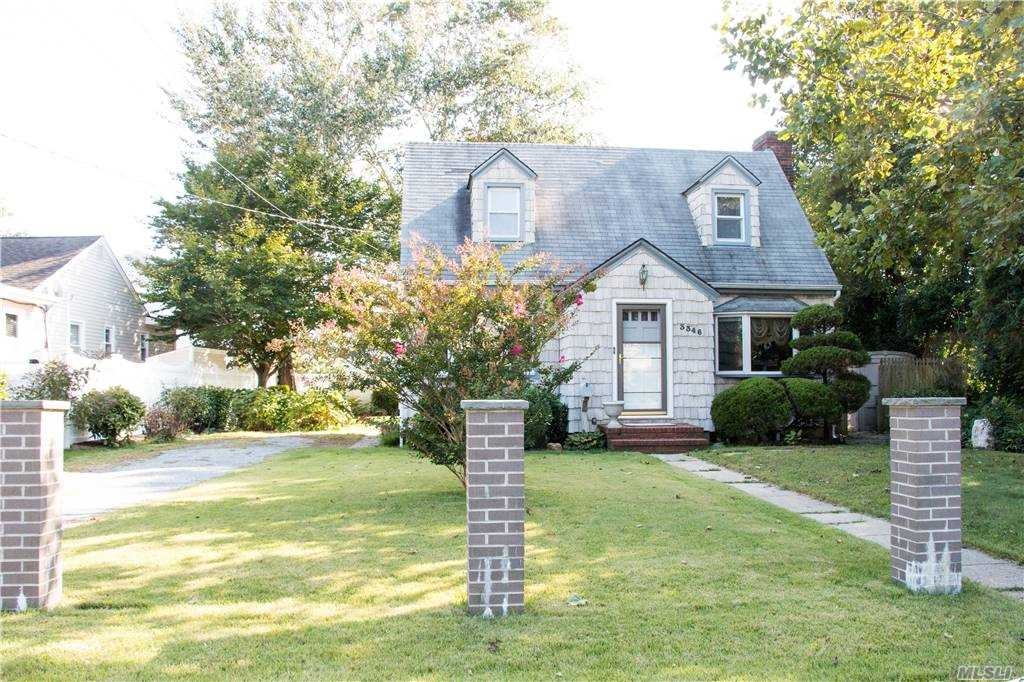 Don't miss out on this gem in Wantagh Woods, cape cod with rear dormer, entry foyer, formal dining room, large living room with fireplace & french door to spacious backyard, 2 bedrooms, 2 full baths and a full finished basement, all upgraded windows, gas heat for super low maintenance, close to Wantagh train station, great price point for location, cozy up in front of the wood burning fireplace for years to come.
