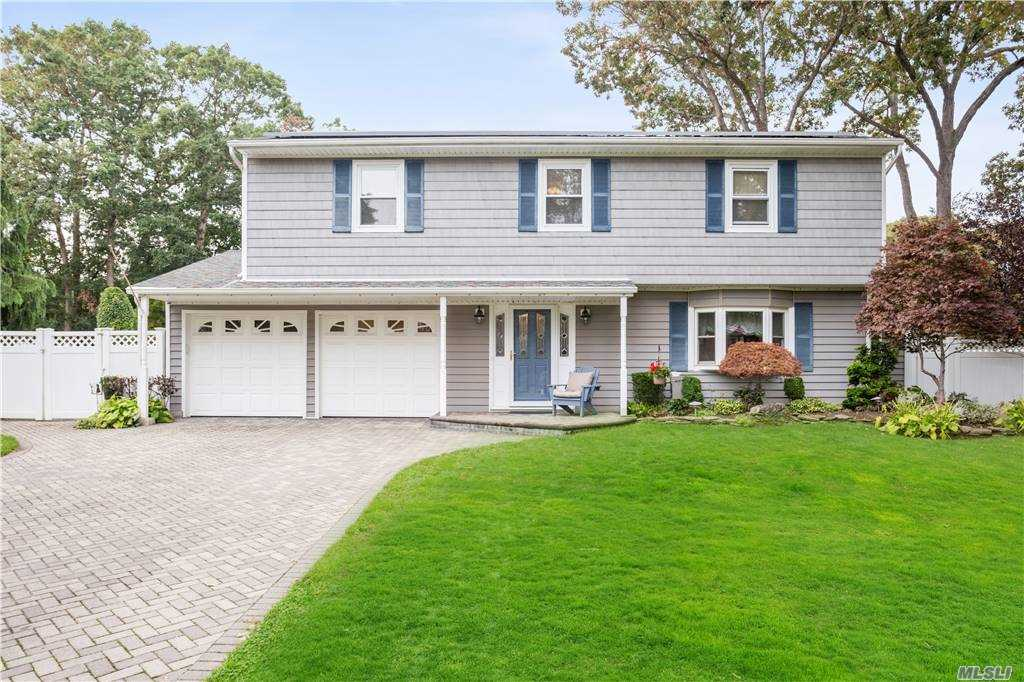 This is a beautiful 4 bedroom 2.5 bathrm splanch. Brick driveway, expanded eik. Gorgeous entertaining yard. In ground heated salt water pool, 2 yr old liner, with a roll out solar cover surrounded by brick pavers. Professionally landscaped with custom lighting and fenced dog run. updated windows, roof, kitchen and bathrooms. Solar panel for very low electric bills. 2 car garage. Central air. PVC fence.200 amp service, generator hookup.