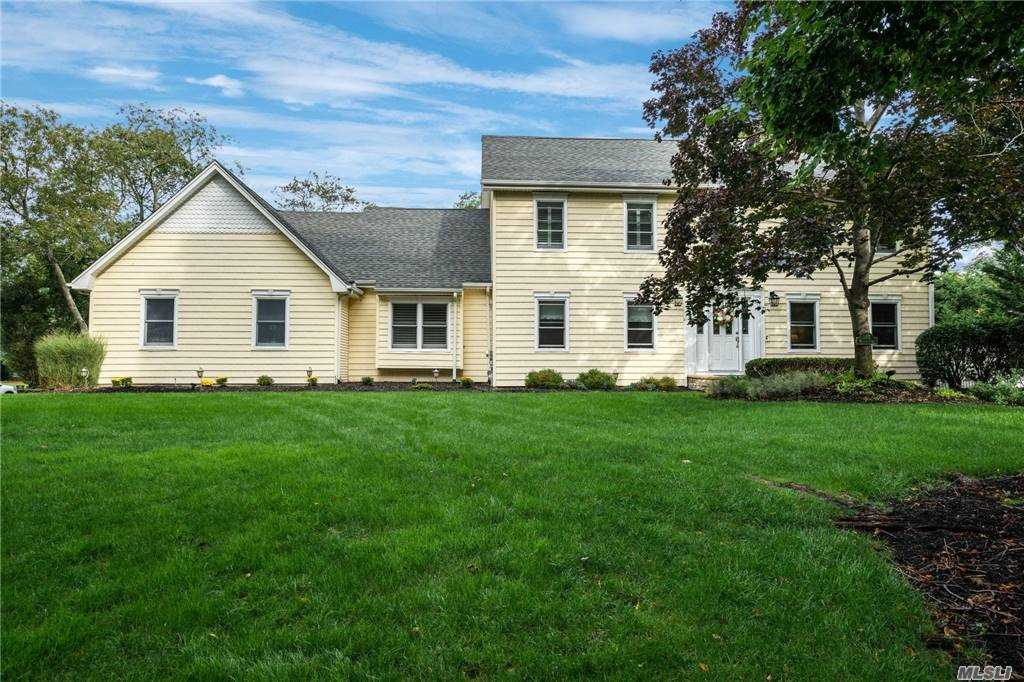 Vacation at home in this perfectly updated Island Estates colonial. The Country Club backyard boasts a fenced, heated Saltwater inground pool with a brick patio, Trex deck with a large awning, basketball court, shed, and mature professional landscaping on a private shy 3/4 acre of property. This home offers a custom kitchen. Quartz countertops and gas cooktop, Brazilian cherry floors, gas fireplace, new master bath w. Cambria countertops,finished basement provides the perfect home office,play area and gym , too many updates to list. This special home is just minutes away fromStony Brook University and Hospital, West Meadow Beach, Port jefferson Ferry and is just 60 miles to Manhattan. Quarantine in Style !!!