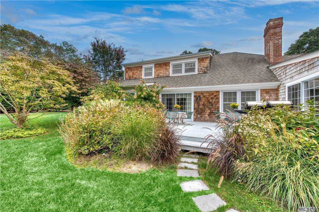 This charming & beautifully maintained traditional home on one of Remsenburg's loveliest streets boasts 6 bedrooms & 5 1/2 baths. Amenities galore include in-ground free form pool beautifully landscaped for privacy, and Har-tu tennis court. Formal living & dining rooms, eat-in gourmet kitchen with granite countertops, spacious family room, 2 wood burning fireplaces, and master bedroom suite with fabulous walk-in closet with custom cabinetry. Central air, security system, and attached 2 car garage. Too many details to list, a must see!