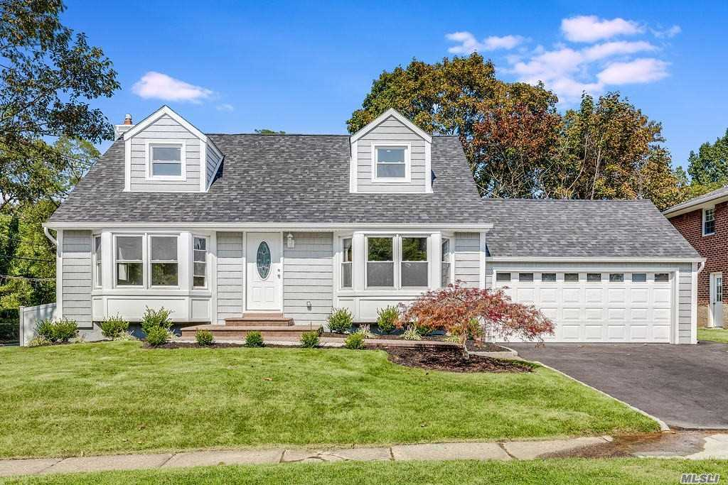 New To Market !  Brand new totally renovated home! 4 bedrooms and 3 full baths.  Open and spacious layout. Gourmet kitchen with granite island.  Full finished basement with walk out separate rear entrance.  Includes play area, washer/dryer, and storage areas. Syosset Schools! Taxes have been grieved for 2021, and awaiting outcome.  Owner will credit buyers attorney in escrow for two years, with the amount depending upon adjustments.