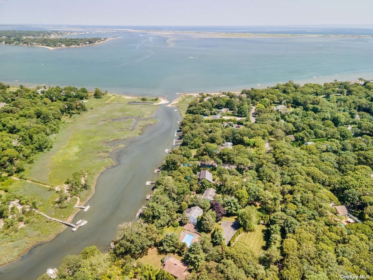 Secluded three bedroom three bath waterfront home located in a private community south of the highway. Enjoy over an acre of beautiful grounds, large heated pool, boat dock with double jet ski ramps and gorgeous bay views.