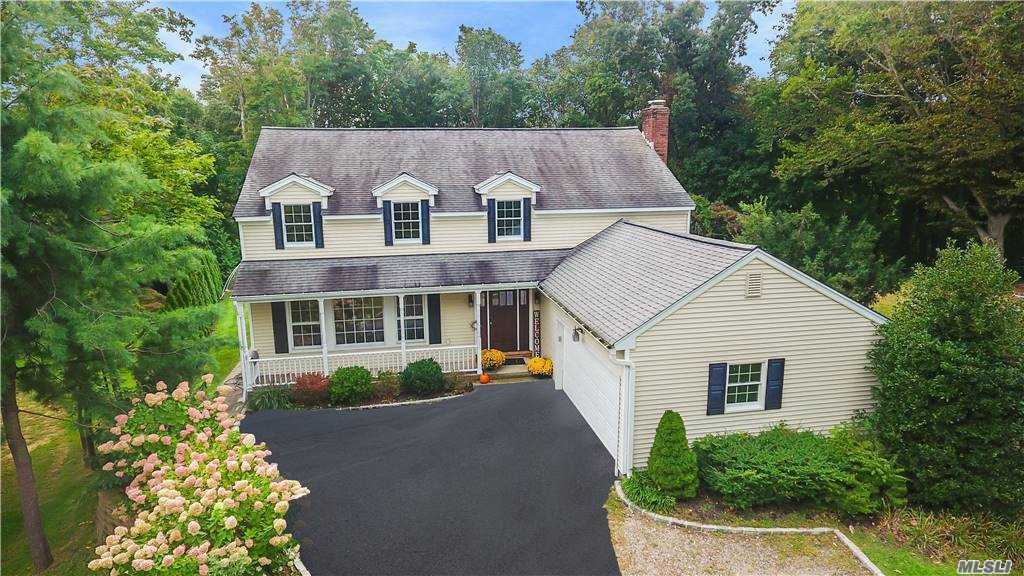 North Greenlawn Village: beautiful updated colonial in pristine condition. Hardwood floors throughout, foyer, living room, dining room, gourmet kitchen, wolf stove, island, granite countertops, leads to beautiful large breakfast room. Family room with wood burning fireplace, mud room and powder room, large 2 car garage w attic. Lower level with playroom and separate home office. Upstairs master w bath, full bath, plus 4 additional bedrooms. Taxes with STAR $15,226