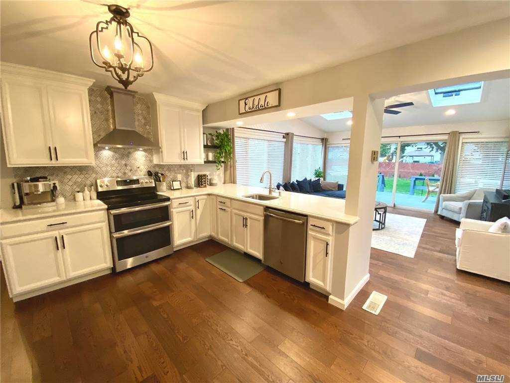 Expanded Sun Drenched Home w/Designer EIK*Quartz Counters*Built in Microwave*Stainless Energy Efficient Appliances* EIK Opens into Sprawling Family Room w/Vaulted Ceiling & Sliders onto the Deck*Updated Baths* Master Bedroom w/Sitting Area or Office *2 Large Closets*3/4 Bedrooms*Andersen Windows*Wood Floors Wrap around Deck *Private Level Fenced Yard*IG Sprinklers*Large Basement w/ Exercise Area*Raised Panel Doors Quiet Neighborhood*Close to Parks* Beaches & Shopping**Award Winning Schools***Low Taxes*** Security Lights