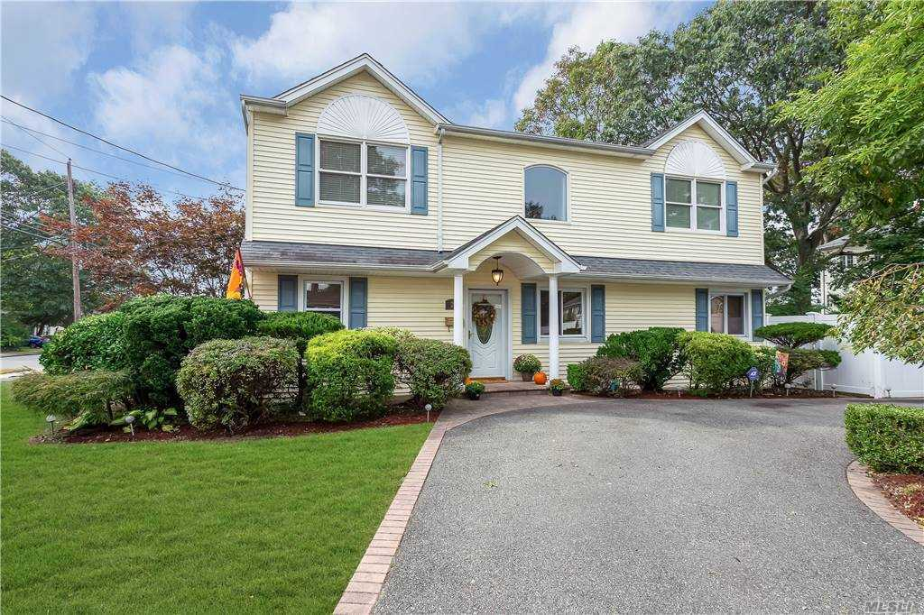 Beautiful colonial boasts spacious rooms that flow with ease for entertaining, This 2100 square foot home features 4 large bedrooms, 2 new full baths, and a finished basement. Living areas flow into large dining and eat-in kitchen area. Main level includes formal dining room, large family room, newer full bath, and eat in kitchen with sliders to trek deck. Second floor features 4 large bedrooms and full bath with ample closets. Enormous private yard with new PVC fence. Close to shopping and transportation! Massapequa Schools!