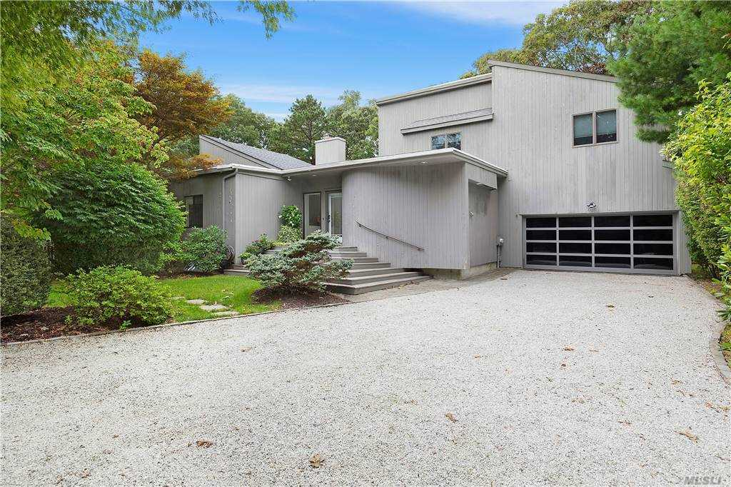 New to the market.  Turn key chic contemporary with 5 bedrooms including master on 1st floor.  Open floor plan with access to a  beautiful, Hamptons yard with a htd., saltwater gunite pool, glass railings, upper level lounge, firepit & retractable awning.  Full basement, 2 car garage & community water access.  A destination home that is move in ready.