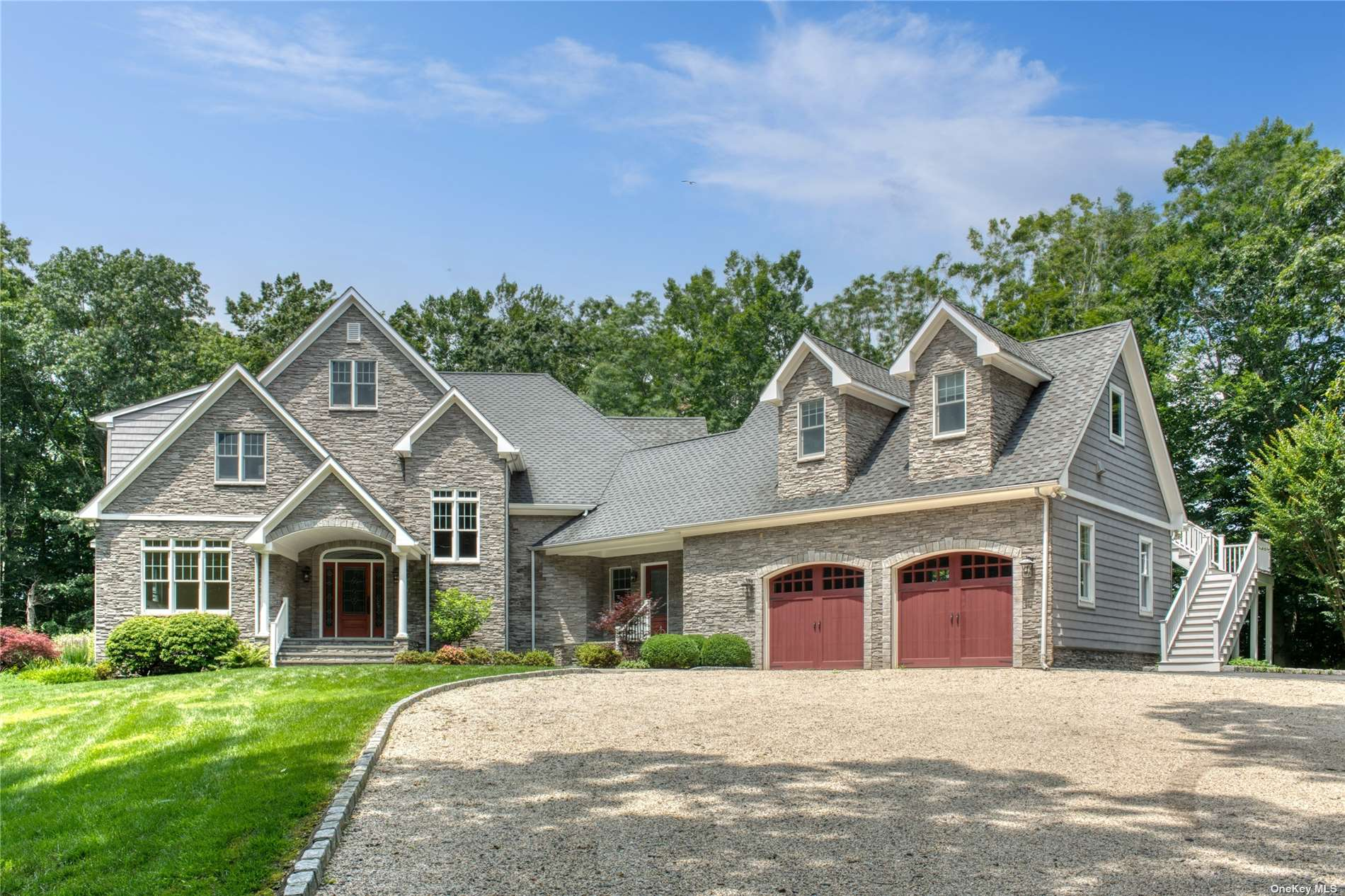 Live the North Fork dream! Beautifully appointed very private estate surrounded by woodlands and farmland. Entertain guests and family in your Great Room while a fire crackles in the beautiful stone fireplace which adjoins a huge Gourmet Kitchen with plenty of pantry space, Granite counters and a Large Island with additional sink, refrigerated wine storage, and entertaining space. There are 3 large bedrooms upstairs which adjoin a common sitting or play area for guests and family. Huge First Floor Master Suite includes a private Home Office. Walk out the french doors onto a patio where you can have coffee in the morning in complete privacy as you overlook gorgeous woodland and farmland. The basement includes 10' ceilings  and plenty of room for a putting green, pool table, and media room and to practice your golf swing! This Bucolic Beauty will not last!