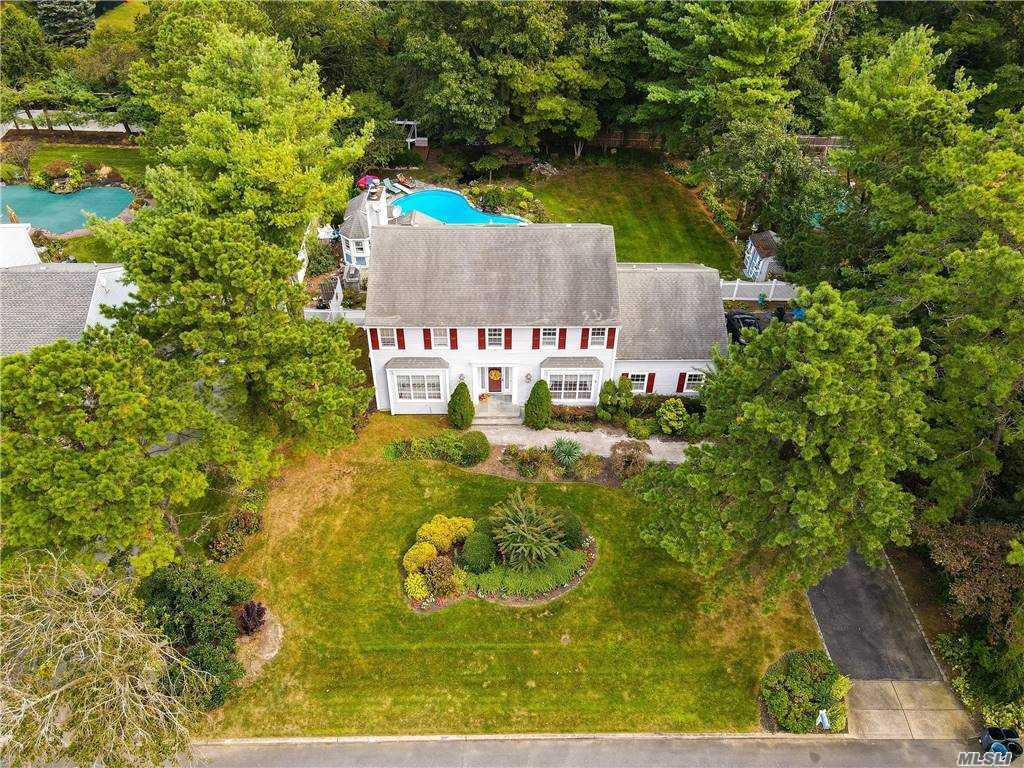 Immaculate Colonial in Evergreen Estates. Half Hollow Hills School District. 4-Bedroom / 3.5 bath. Open floor plan with large foyer, wood floors throughout and stainless steel appliances. Backyard is Gorgeous!! In-ground heated pool, brand-new 4-person hot tub, Koi Pond, & Pool House. MUST SEE!!
