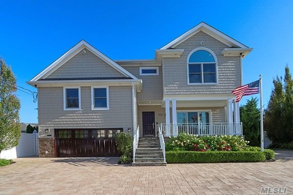 Live it up in this 4700 sq ft 5 bedroom 4.5 Bath Split. Rebuilt from the ground up, nothing was over looked.  This home truly has it all. Large Gourmet KOSHER EIK. Granite Countertops, Formal Dining room w/built ins, Living Rm w/surround sound & Gas Fireplace. Lower Lever Den w/bathroom, Mudroom, Finished Basement w/Laundry, playroom and gym. Resort like yard w/Heated Saltwater pool & Outdoor Kitchen w/gas BBQ, Whole House Generator. Central Vac, 2 Car Attached Garage w/epoxy floor. Water Filtration System. Leased Solar Panels, Many more features. Too much to list. Close to shopping and houses of worship. NO FLOOD INSURANCE REQUIRED