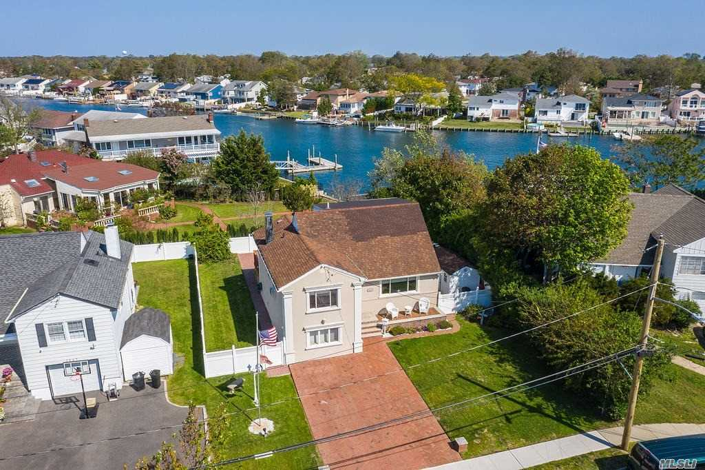 Beautiful Waterview Expanded Split in the heart of The Estates section of Oceanside. Enjoy sunshine and sunsets from the private south-facing front porch. The bright living room with a large window opens up into your formal dining room & eat-in-kitchen.  Family Room extension with sliders leads out to the rear deck.  4 Spacious bedrooms 2 beautiful full bathrooms, SS appliances in the kitchen. Very low flood insurance. Move right in and unpack.