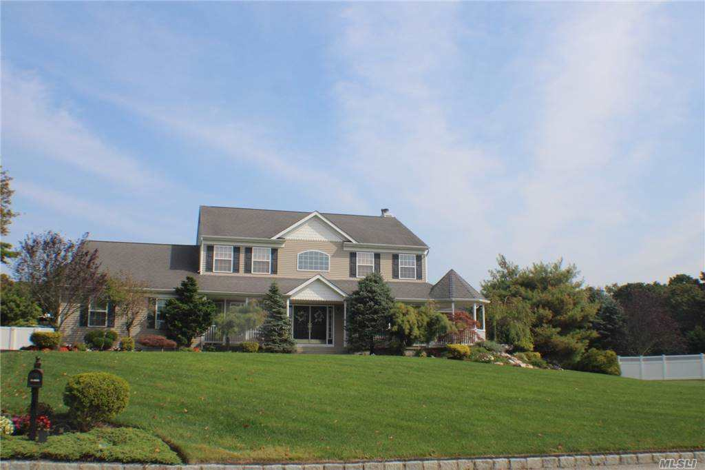Desirable East Moriches Schools (Choice of Westhampton, C Moriches or ESM). Beautiful home from top to bottom with open floor plan w/professionally landscaped front and back .Dual fireplace seen from Den and Sunroom. Plenty of room for extended family you won't run out of room here. Mountain Lake pool w/beautiful pavers and custom designs. Beautiful stone waterfall