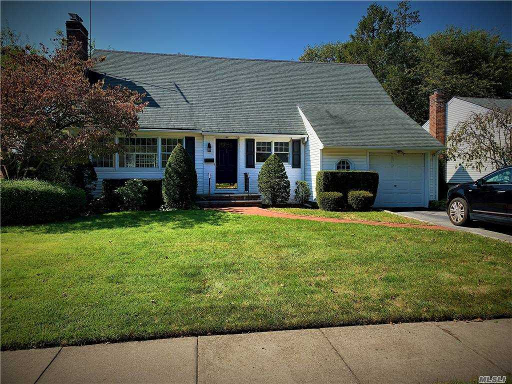 Home located in Presidential area of Garden City, GC Schools, with close proximity to 2 Long Island Railroad Stations.  This wide-lined cape offers the opportunity for a master-bedroom on either the 1st or 2nd floor.  The extension off the kitchen truly makes this a real eat in kitchen. Central air condition and gas heat are enjoyed in this home with new hot water heater .   Just add a little TLC and your personal touches and this house will become truly a home for a life time.  Homes in immediate area with updates have sold for over a million dollars. We are here to listen to all offers.