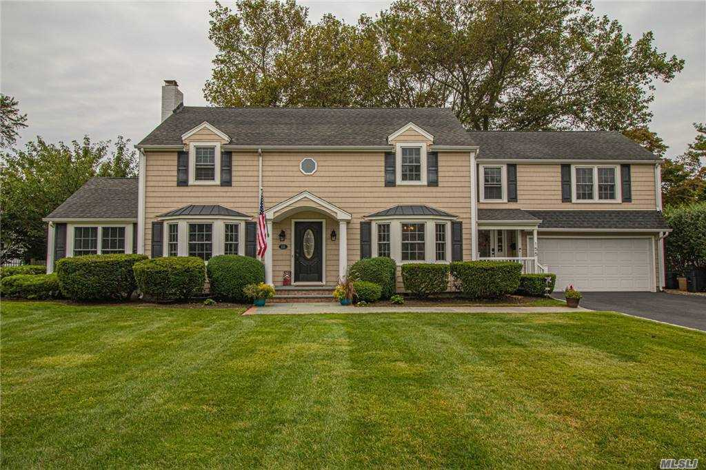 Beautiful 4 Bedroom Colonial, All New Wood Floors Throughout, Custom Moldings, Living Room With Lovely Fireplace, Formal Dining, Den with Fireplace, & Sun Room. Central Air Conditioning, Radiant Heat in Kitchen & Brand New Upstairs Master Bath, Built-In Hardwired Speakers Throughout 1st Floor, 2 Skylights, 2 Car Garage, & Outdoor Patio. Just A Block From Canal Docking & Residents Beach Club! Large Park-like Property. You Won't Want to Miss This One!