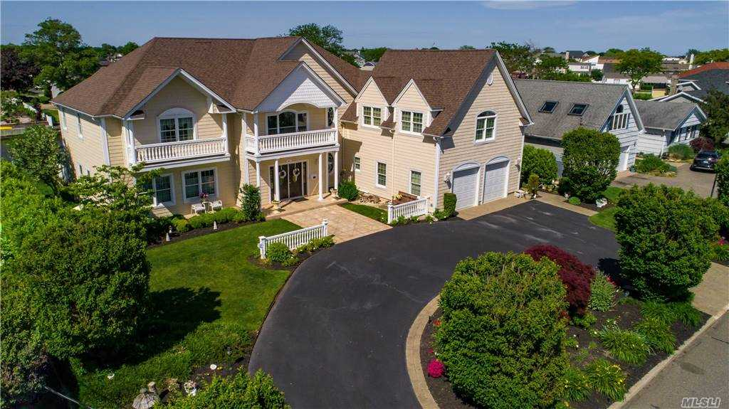 Approx 5000 Sq Ft Magnificent Post Modern Custom Built In 2004, Cathedral Center Hall W/Princess Staircase,5 Brs, 4.5 Bths, Gourmet Kitchen W/17' Center Island, Butler Pantry,Mstrsuite W/Fbath Wic & Fp, 2nd Flr Grt Rm, Amzing Bonus Rm W/Bar & Billiards,Mahagony Deck,105' Navy Bulkhead On Deep Water Canal, Dock Has Elec & Water. Brand New Roof Being Added. Boaters Delight & Bayviews Abound!! Taxes are $37,187.64 including village.