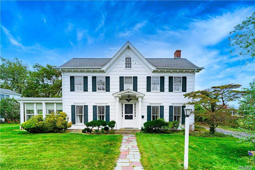 Abraham & Mary Lincoln could have lived here in this Classic 1840's Center Hall Colonial featuring Original Custom Wood Work, All Large Rooms, 4 Bedrooms, 1.5 Baths, Eat-In-Kitchen, Formal Dining Room, Family Room, Screened in Porch, Quiet Street, Lake Front Location, Updated Heat and Roof, Oversized Property and 2 Car Attached Garage. Authentic character with built-ins, hand made hardware and trim.