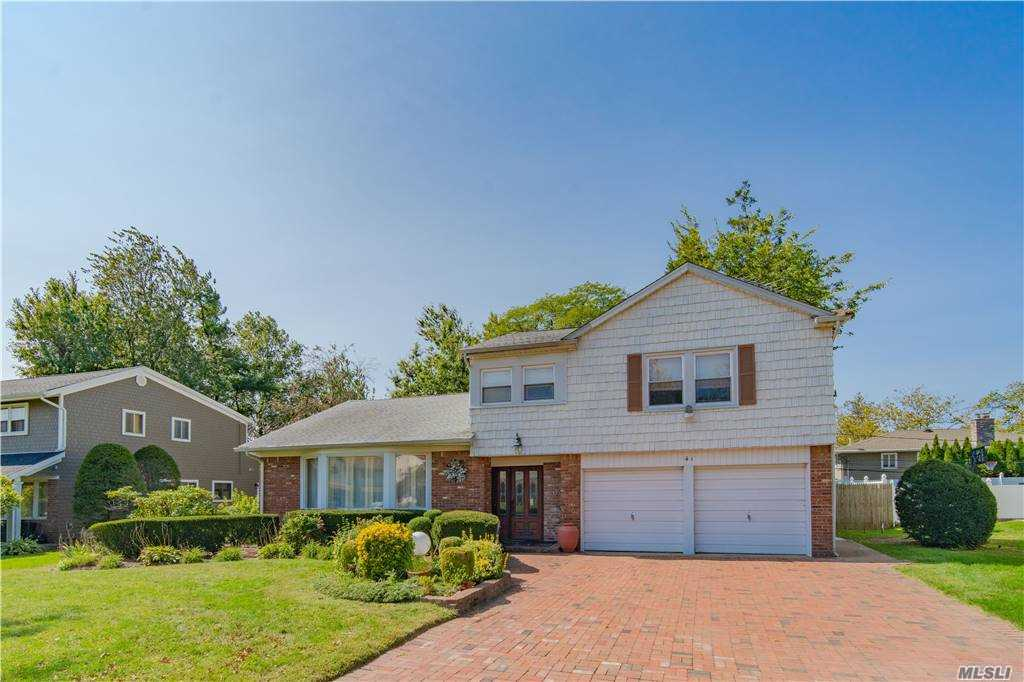 "EASY TO SHOW. Make an offer lets make a deal. Come and see this beautiful Split home boasting 3/4 bedrooms and 2.5 baths located in heart of Manhasset Hills. Large living room and family room with fireplace. Customized eat-in kitchen with skylights. Full finished basement with customized closets and tons of storage space. Nice backyard with huge deck. Paved brick driveway with attached 2car garage. Half block away from ""Rider Pond."" Easy access to Highways, shopping, hospitals, 25 minutes to city. Zoned for Herricks schools. And much more. Must See!!Wont last!!"