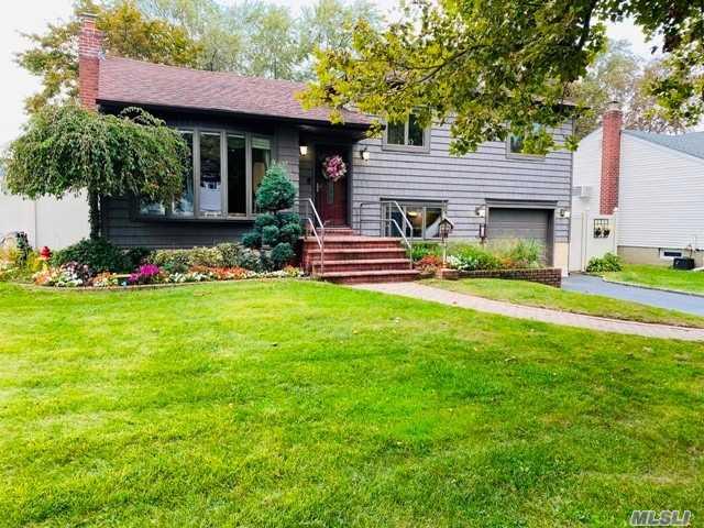 Location, location, location! Lovely Split located in Farmingdale Village, Lenox Hills, near parkways, Main St, & train station. This large Split features 4 levels. Top level features 3 bedrooms & 1 bath, plus some attic storage. Large living room, dining room, updated kitchen w/ white cabinets & granite. Sliders to back deck which overlooks large backyard. 3rd level features family room, 1/2 bath, garage w/ interior entrance, storage & mud room, plus entrance to backyard. Basement level features laundry, 2 finished rooms perfect for at home learning or work from home, plus utility, & boiler. Updated siding & roof, boiler brand new, oil tank brand new, 200 amp electric, automatic garage door opener, sprinkler system in front yard, new shed for extra storage. This large home has so much potential to become your dream home! Northside Elementary.