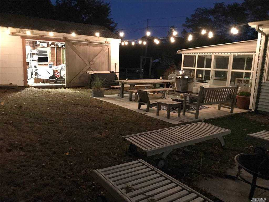 This sunny 3 bedroom, 2 bath home is located South of the highway, a mile from Shinnecock Bay and 2 miles from Ponquogue Ocean. Sleek custom and lighted cabinetry is throughout the house. A traditional fireplace centers the open living/dining area. The kitchen and bathrooms are newly renovated. Central air and irrigation system in place. Room for a pool. Garage, enclosed porch, and a separate patio area complete this chic house.  Many updates.  The roof is 5 years old.  AC/Heat replaced in 2019. The kitchen and baths were renovated in 2019.  Natural gas for heat, hot water, stove, and dryer. See Virtual Tour and Floor Plan!