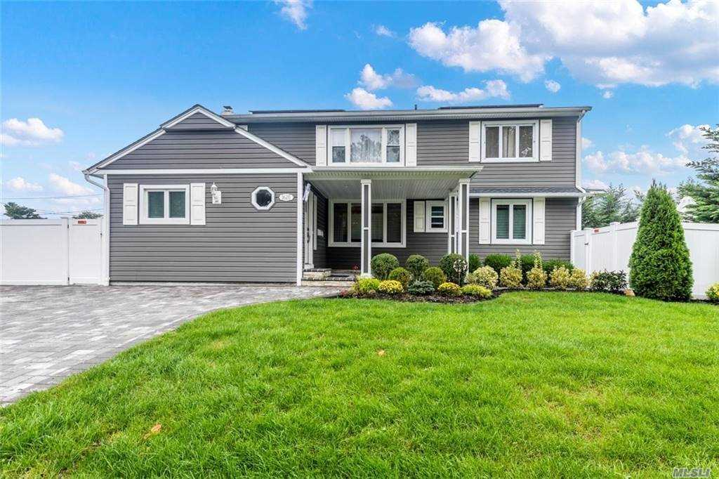 Magnificent Expanded Ranch house. Possible Mother Daughter w/ proper permits nestled in a lovely tree lined street of the esteem Barnum Woods section of East Meadow. This Elegant House features with a beautiful porch with spacious Entry Foyer, luxurious pavered Backyard, marvelous Swimming Pool, Rmtly Retractable Patio Awning. Spacious Lvng, Dng area, Fmly rm/Den. Eat-in kitchen w/Grnte counters, Stnlss Steel Appli. and Island. 1st flr Hardwood flrs thru-out! Mbrm w/ MBath, 2 bdrms, 1bth.   2nd Floor Lvng Rm, 2 Bdrms, 1 bth.   Full walk out Basement with boiler/htwtr, washer/dryer. SUPER LOW TAXES $11,500 without STAR, OWNED SOLAR PANEL, 4 Ductless units for Heating & Cooling, Super Energy Efficient (current owner pays only around $12/mo electric bill), Private Fenced Backyard, 3 zone Sprinkler system in Front yard. Artificial Mntnce free Lawn in Bckyrd. GOLDEN OPPURTUNITY! Showing by appt only. Pre-approval & Covid forms prior to visits. Gloves & Masks please!