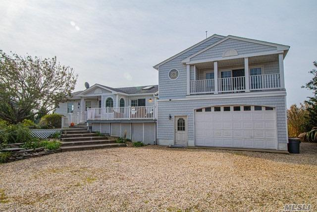 Diamond Waterfront - Surrounded by magnificent Views-  Water on State Boat Channel. - Gorgeous Sunsets -Robert moses Bridge.  Magnificently designed & Constructed with a different view in every room.  Tastefully decorated thru-out.  New kitchen & Baths -pretty much all new inside & out.  Alot of thought went into the construction and designing of the home!-125' dock- New Boat lift,   4 Car Garage.  Leased land till 2065.Addtl Cost of $275 a month