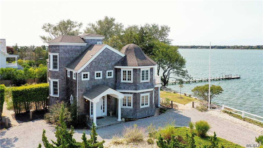 'Flying Cloud' a gorgeous light-filled cedar-shingled Hamptons style home designed by architect Brian Brady is now available for private showings.  It has 2 bedrooms, 2.5 baths, a den/office with commanding views of the water, a spa room that could be transformed into a 3rd bedroom with sliders out to a small patio and at the top of the home...a cozy loft! It is located on a private road ending on Tiana Bay in the sought after Rampasture Point area of Hampton Bays.  Too many custom and designer finishes to list.  New bulkheading and staircase to the water and beautifully landscaped with American beach grass to look like the dunes.  Located in a no flood zone.  3.8 miles to the ocean and 1 mile to town.   Virtual Tour, Floor Plans, and Video attached.