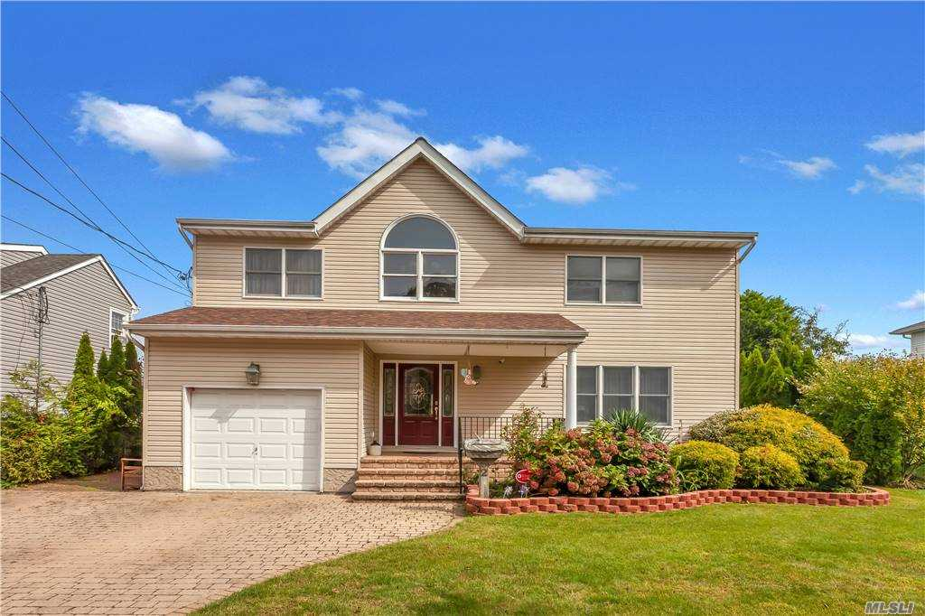Nassau Shores Waterfront Center Hall Colonial with 2500 Square Feet of Living Space Located on Carmen's River! Built in 1999 with 60 Ft. of Bulkhead!Grand Entrance Foyer with Alabaster Chandelier!Step into the Living Room with Ornate Mantel and Wood Burning Fireplace!Sunny Family Room with Vaulted Ceiling, Kitchen and Formal Dining Room give you Million Dollar Views of the Water with a Wall of Windows!Masterbedroom Suite is Enormous with Soaring Vaulted Ceiling, WIC, and Elegant Full Bath with Shower and Jacuzzi Soaking Tub!New Roof!Central VAC, Indoor/Outdoor Speakers,Camera Security System!Entertainer's Paradise Yard with Mahogany Deck,Outdoor Grill, and Jacuzzi Tub on the Canal!Floating Dock and 4 Boat Slips!SOLD-AS-IS!